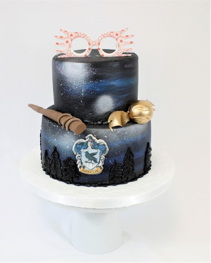 two tier ravenclaw cake, happee birthdae harry, painted in black and blue, luna lovegood's glasses topper