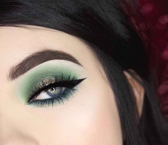eyeshadow tutorial, woman with black hair and blue eyes, green and turquoise eyeshadow colors, black cat eyeliner