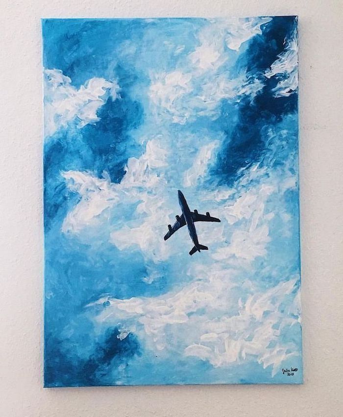 blue and white clouds, painting ideas for beginners, airplane flying in the sky, painting hanging on white wall