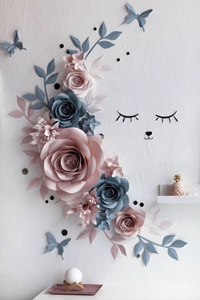 blush and dark grey paper flowers, arranged on a white wall, paper flower templates, different shapes and sizes