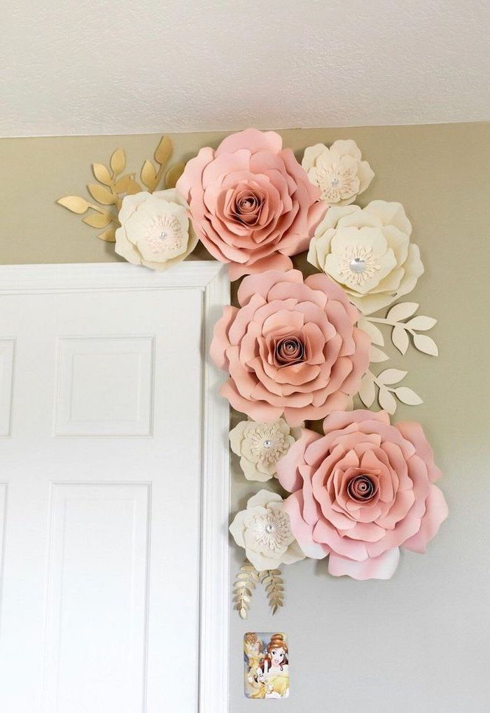 large blush and white paper flowers, arranged together over a white door, how to make tissue paper flowers