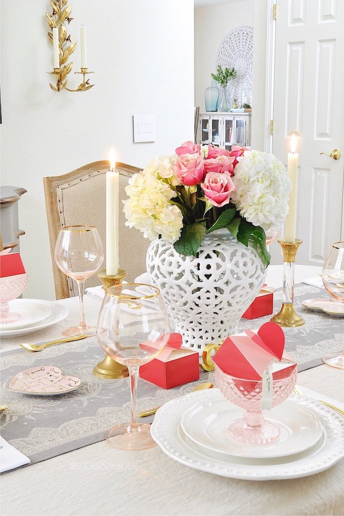 dinner table with flower bouquet in the middle, valentines decoration ideas, glasses with pink carton boxes inside