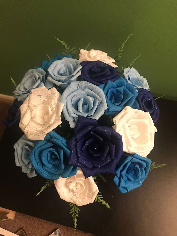 how to make tissue paper flowers, blue and white small paper roses, made of crepe paper, arranged in a bouquet