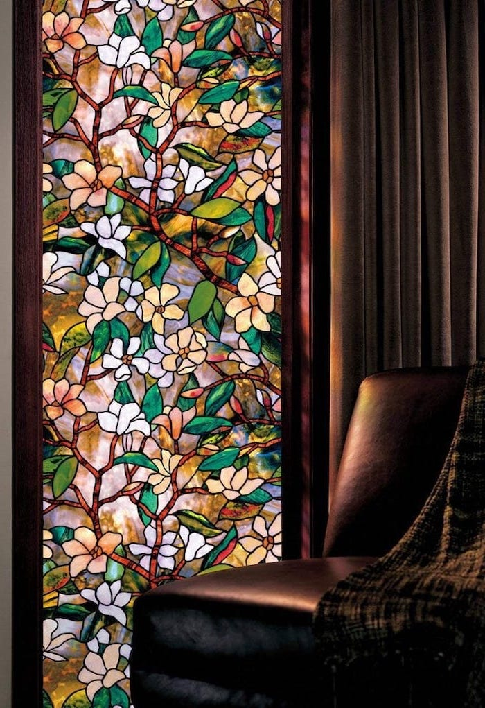 brown leather sofa with throw blanket, how to make stained glass, next to a window decorated with flowers