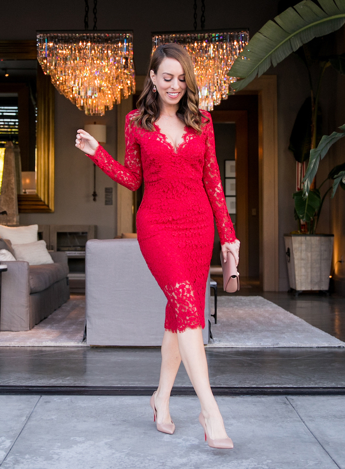 valentines outfits, woman standing on terrace, wearing red lace dress with long sleeves, nude shoes and clutch bag