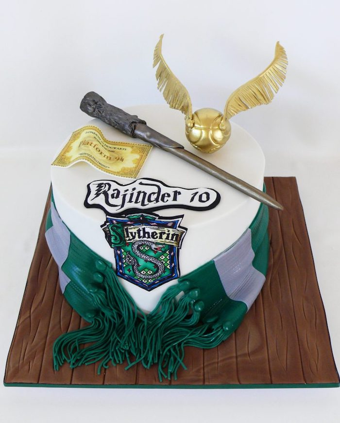 slytherin one tier cake, happy birthday harry cake, covered with white fondant, green and silver slytherin scarf, made of fondant