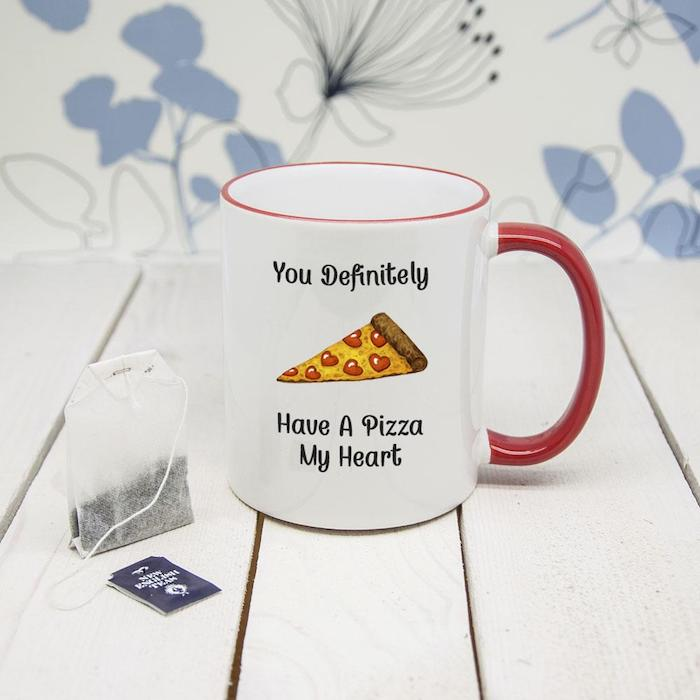 you definitely have a pizza my heart, written on white coffee mug, good valentines day gifts for her, placed on white wooden surface