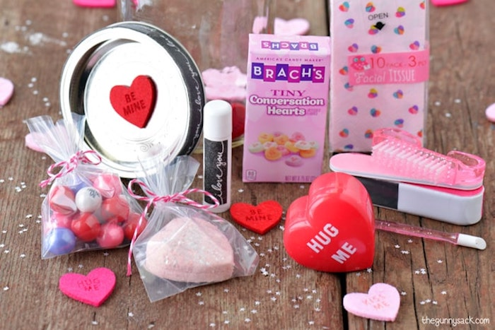 conversation hearts and lip balm, candy and nail kit, placed on wooden surface, valentines day gifts, step by step diy tutorial