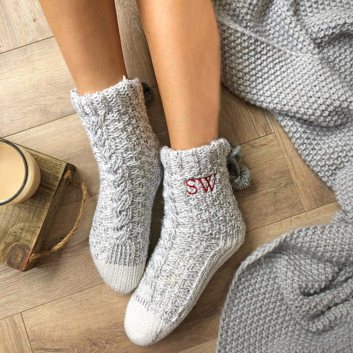 grey knitted cozy socks, personalised with initials, good valentines day gifts for her, wooden floor, grey knitted blanket