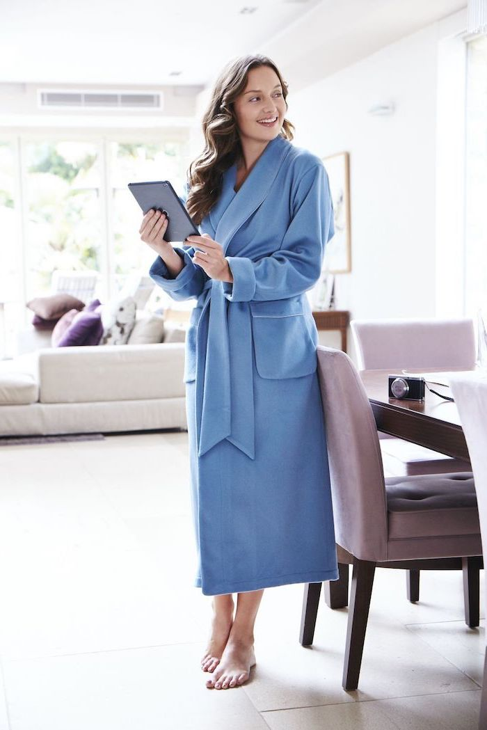 woman wearing blue long cashmere robe, good valentines day gifts for her, standing on white tiled floor