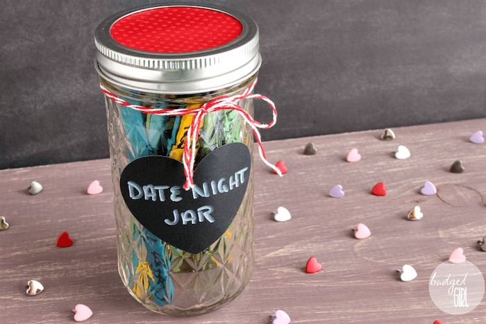 date night jar, mason jar filled with ideas for dates, written on popsicle sticks, valentines day gifts, placed on wooden surface