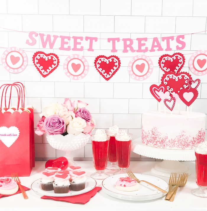 sweet treats banner, hearts garlands, hanging over desserts table, valentines day decor, cake cupcakes and milkshakes on top