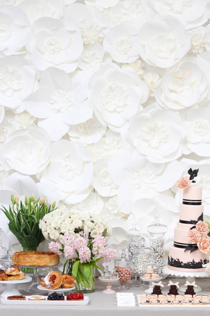 white paper flowers in different shapes and sizes, how to make tissue paper flowers, arranged for a backdrop behind a desserts table