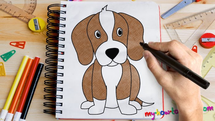 drawing of a dog, colored with markers, cool pictures to draw, white notebook placed on wooden table, pencils and rulers around it