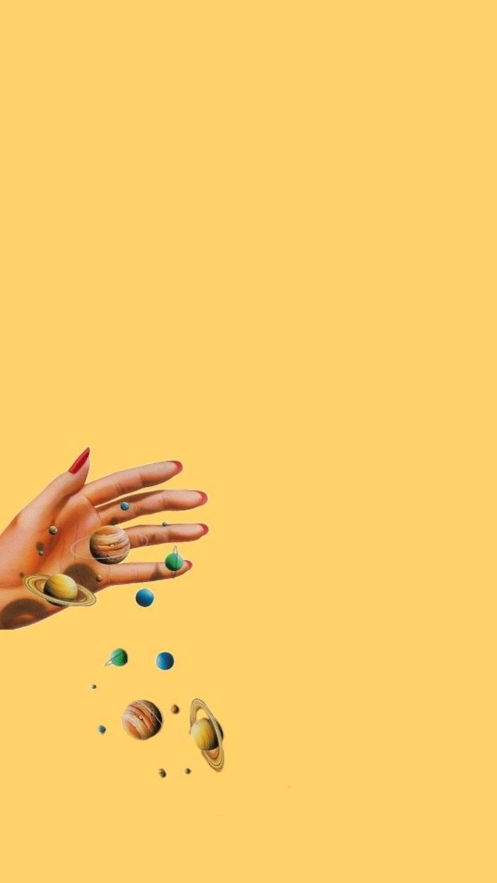 drawing of female hand with red nail polish holding planets on yellow background aesthetic lockscreen
