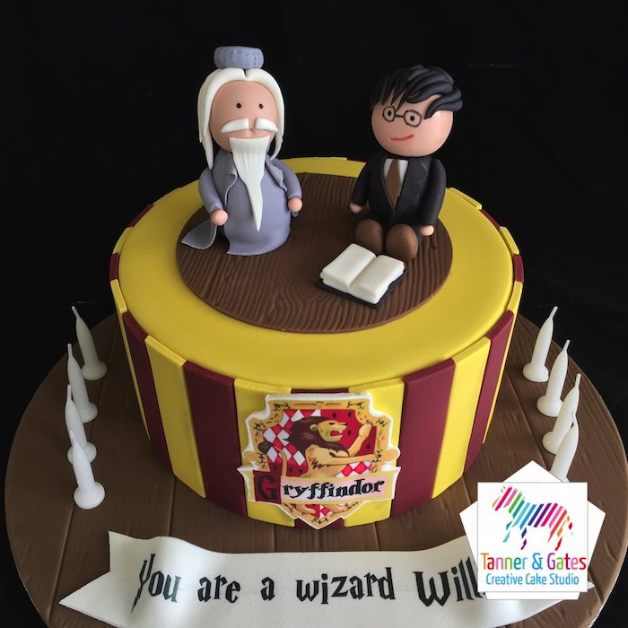 dumbledore and harry toppers made of fondant, harry potter cake hagrid, one tier cake with red and yellow fondant
