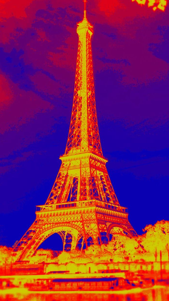 photograph of the eiffel tower in negative, photo with a filter, cute aesthetic wallpapers, yellow orange and blue colors