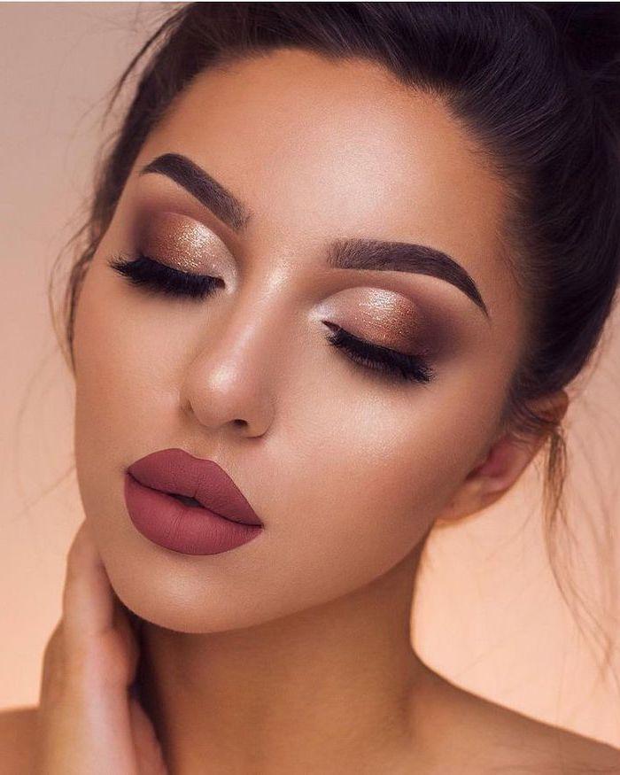 brunette woman with thick dark eyebrows, golden brown eyeshadow colors, dark burgundy red matte lipstick, eyeshadow ideas