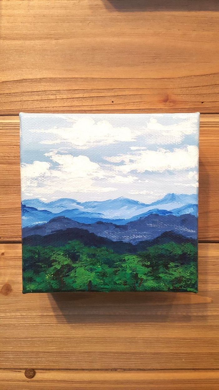 mountain and forest landscape, easy canvas painting ideas, white sky with clouds, over tall mountains and forests