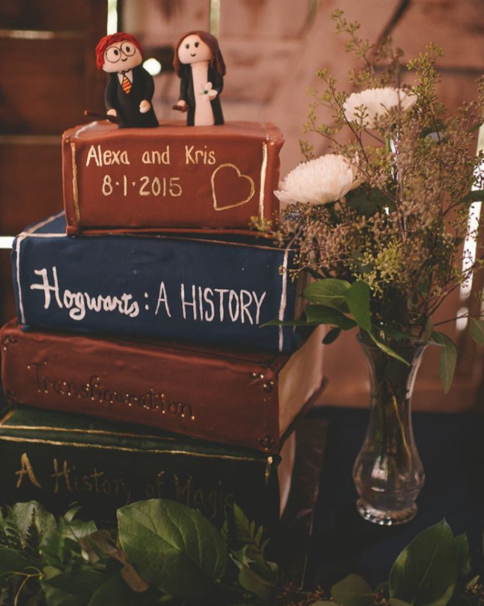 cake with each layer in the shape of a book, hagrid birthday cake, hogwarts a history, a history of magic and transfiguration textbooks