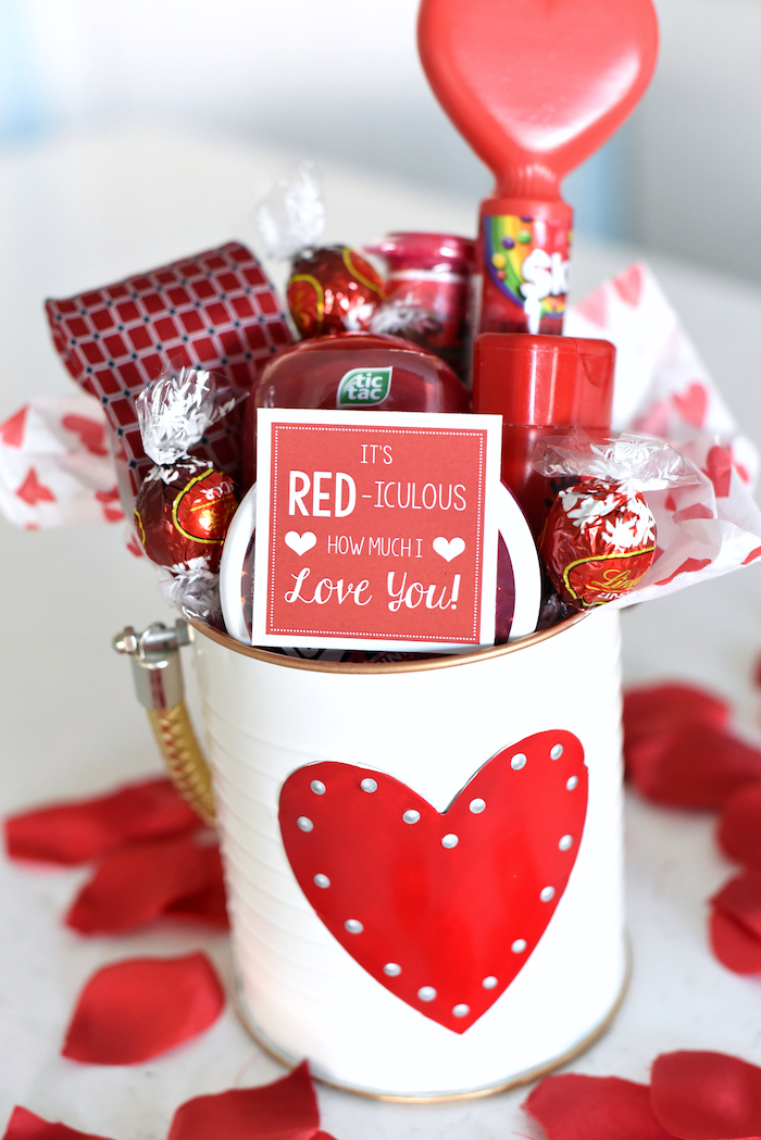 white metal tin can with heart at the front, filled with different candy, romantic gifts for her, lindor chocolates and skittles