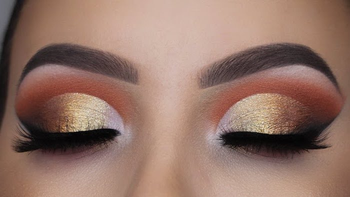 golden orange eyeshadow colors, green eyeshadow, woman with dark thick eyebrows, black cat eyeliner