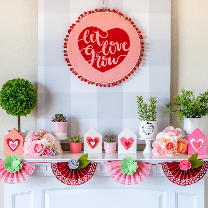 decorations made of paper, valentines day decor, let love grow wreath, hanging over a mantel, potted succulents arranged on top