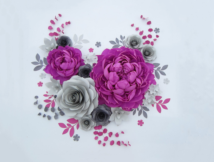 purple and grey paper flowers, different shapes and sizes, giant paper flowers, arranged on a white surface