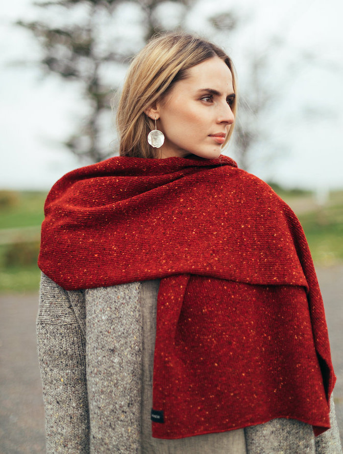 woman wearing a grey cardigan, large red blanket scarf, romantic gifts for her, with long blonde hair