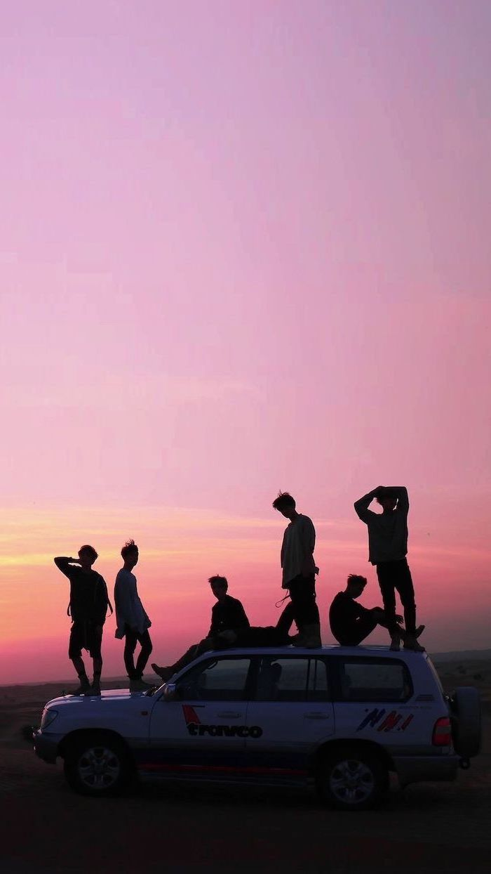 group of friends, standing or sitting on top of a jeep, parked on a road, cute aesthetic backgrounds, sunset purple sky