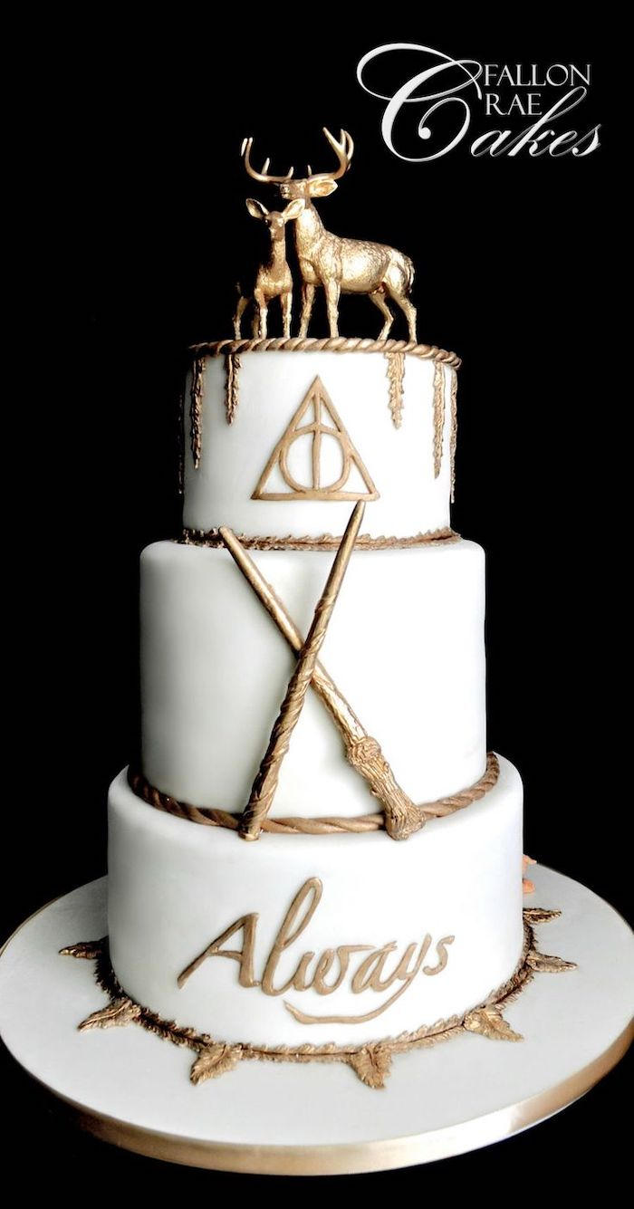 three tier cake, covered with white fondant and gold decorations, stag and deer patronus toppers, hagrid cake