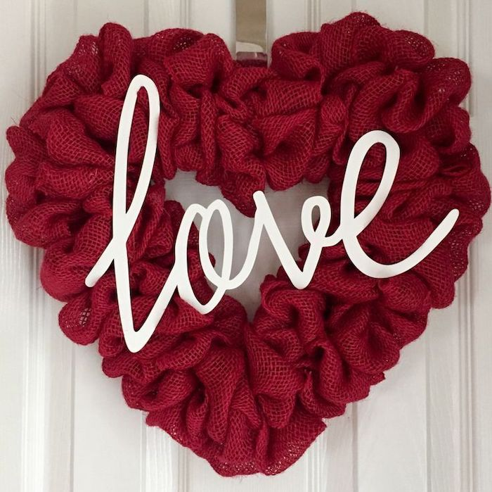 diy valentine decorations, heart shaped wreath, made of fabric, white love letters in the middle, hanging on white door