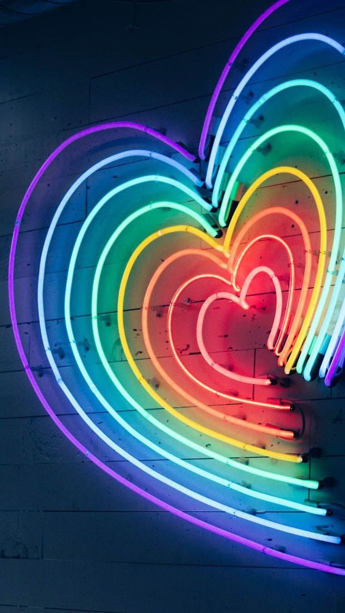 heart shaped neon lights, in the colors of the rainbow, cute aesthetic backgrounds, hanging on wooden wall