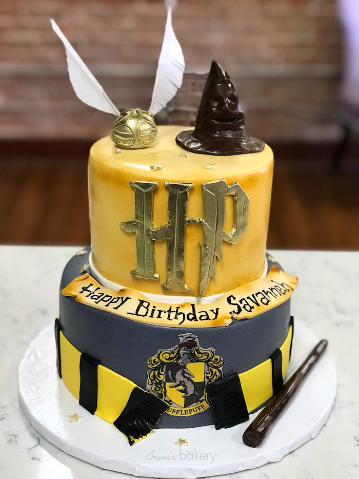 hufflepuff two tier cake, covered with yellow and grey fondant, harry potters birthday cake, black and yellow scarf made of fondant around it
