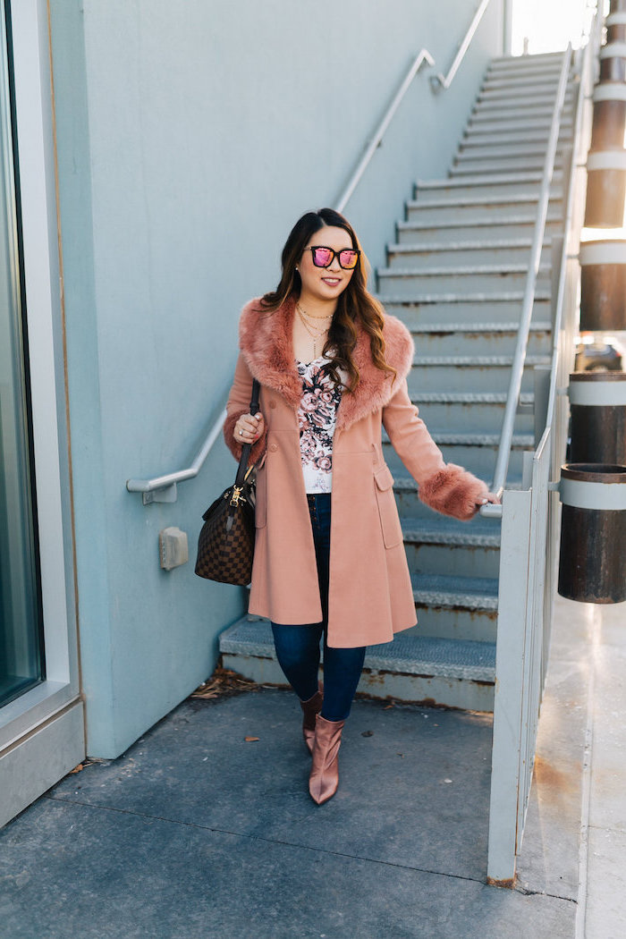 woman wearing jeans, white blouse, long pink coat, pink velvet boots, date outfit ideas, long brown wavy hair