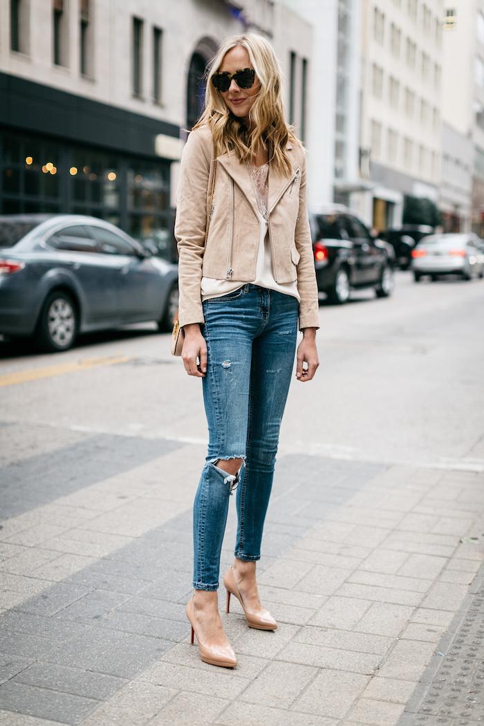 woman walking on sidewalk, wearing jeans, date outfit ideas, white blouse, nude velvet jacket, nude shoes