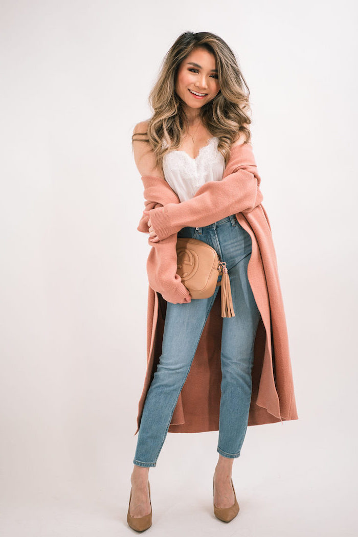 blonde woman wearing white top and jeans, date outfit ideas, long pink coat, date outfit ideas, nude shoes and clutch bag