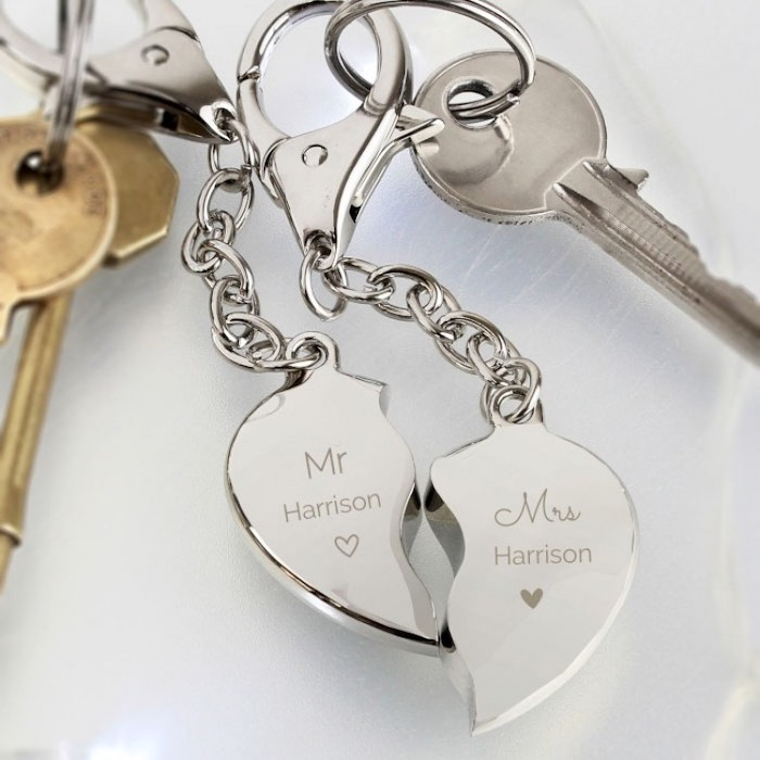 heart shaped key chain split in two, personalised with mr and mrs harrison, best valentines gifts for her, placed on white surface