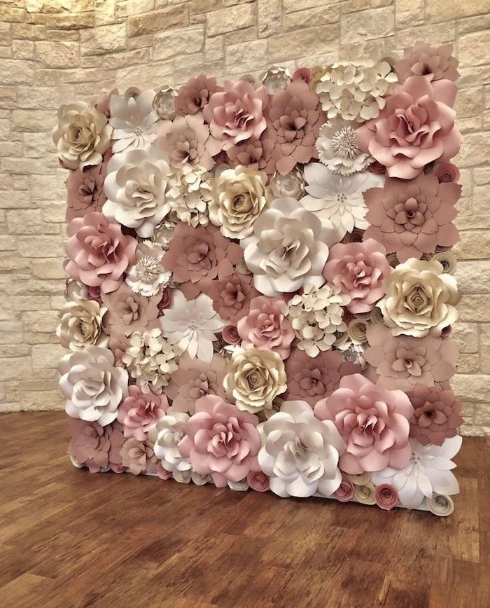 backdrop made with blush white and gold paper flowers, different shapes and sizes, paper flower wall decor, wooden floor