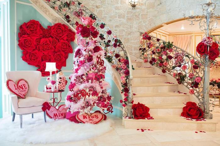 large staircase decorated with flowers, tree decorated with hearts and flowers, diy valentine decorations, pink heart shaped throw pillows