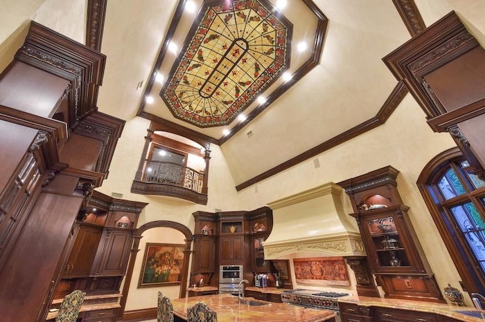 kitchen in vintage style, wooden cupboards, stained glass window hangings, ceiling window surrounded by lights