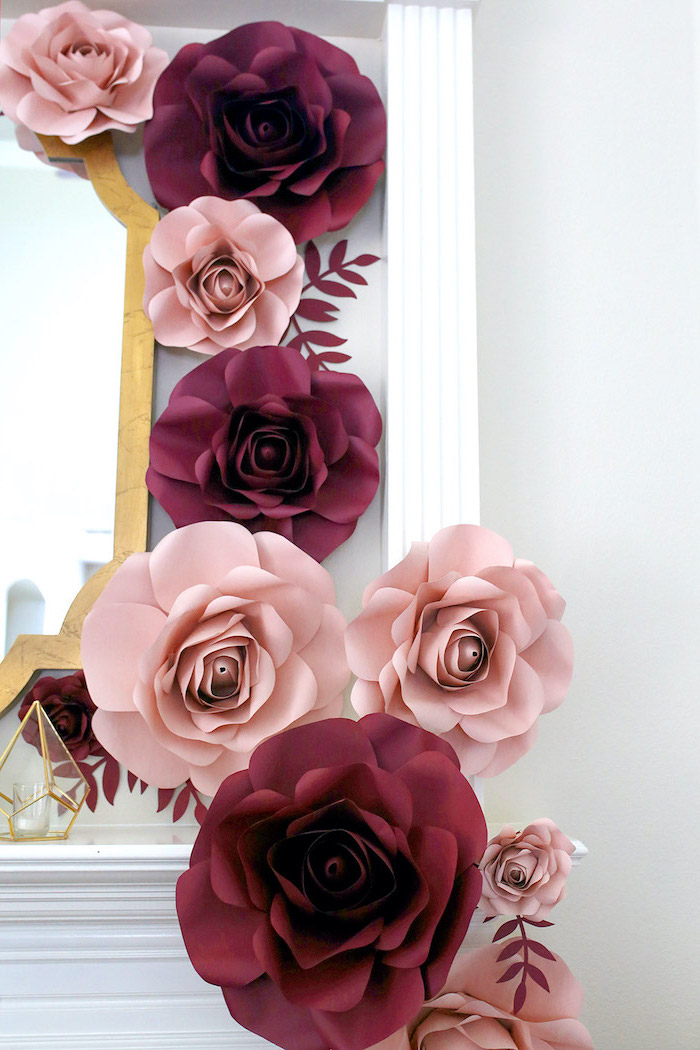 how to make flowers out of tissue paper, blush and pink paper flowers, arranged around a mirror, hanging on a white wall