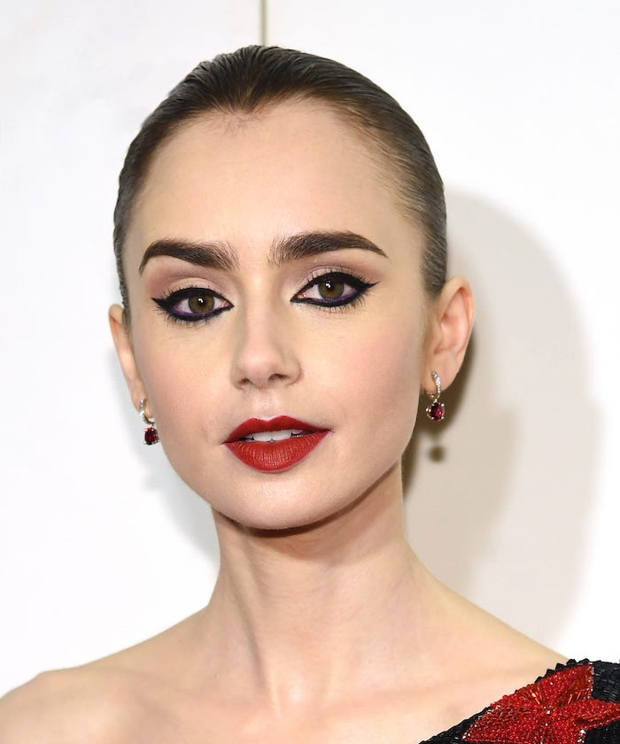 lily colins, photographed on the red carpet, how to do eyeshadow, nude eyeshadow colors, black cat eyeliner, dark red matte lipstick