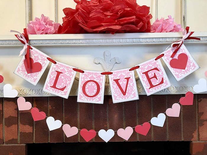 love banner, hearts garland, hanging over mantel, outdoor valentine decorations, large paper flowers on top