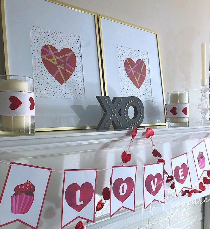 love banner, xo sign with lights, candles and hearts posters, arranged on white mantel, outdoor valentine decorations