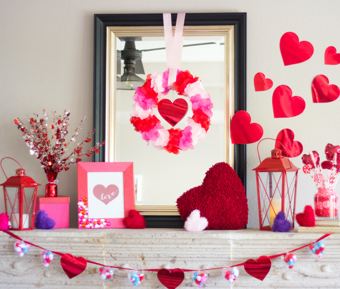 pink and red decorations, arranged over white mantel, valentine lights, hearts and wreaths, hearts garland and photo frame