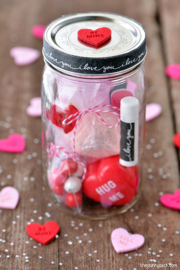 mason jar filled with different things, valentine gift ideas, placed on wooden surface, step by step diy tutorial