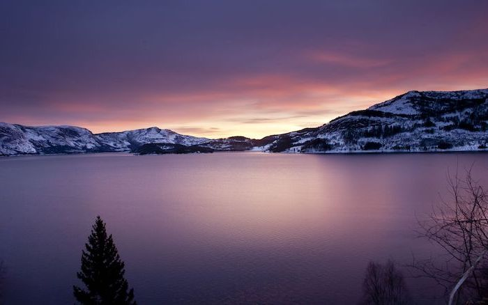 lake with glass surface, surrounded by snowy mountains, photographed at sunset, aesthetic phone wallpapers, mountain landscape