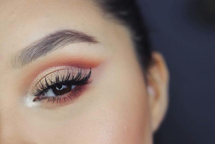 nude and orange eyeshadow colors, on woman with brown eyes, long black eyelashes, how to do makeup