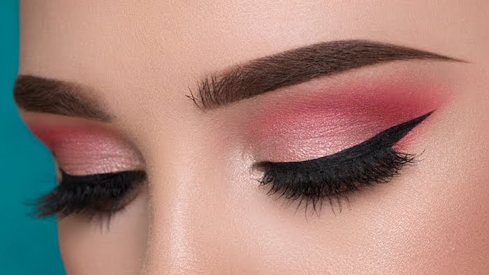 red and pink eyeshadow colors, black cat eyeliner, how to do makeup, woman with dark thick eyebrows